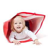 The girl inside the packet. Cute little boy inside a red packet. Concept of own toy house Royalty Free Stock Images