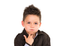Cute little boy isolated thinking over white Royalty Free Stock Image