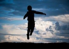 Cute little boy jump Stock Image