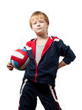 The cute little boy in a jumpsuit holds a volleyba royalty free stock photography