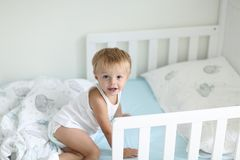 Cute little boy just woke uo from the nap time and is happily smiling stock image
