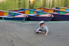 Cute little boy by lake Stock Image