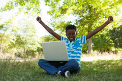 Cute little boy with laptop Stock Photo