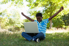 Cute little boy with laptop Royalty Free Stock Image