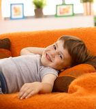 Cute little boy laughing on couch Royalty Free Stock Image