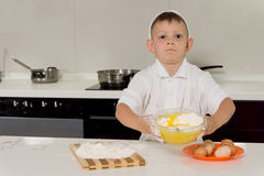 Cute little boy learning to bake Royalty Free Stock Photography