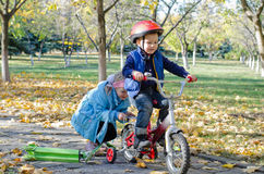 Cute little boy learning to ride Royalty Free Stock Image
