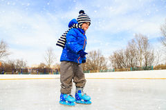 Free Cute Little Boy Learning To Skate In Winter Stock Photography - 61906942