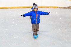 Cute little boy learning to skate in winter Royalty Free Stock Photos