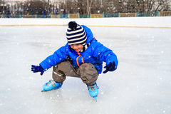 Cute little boy learning to skate in winter Royalty Free Stock Photography