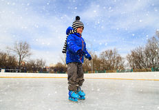 Cute little boy learning to skate in winter Stock Image