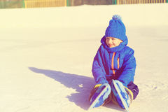 Cute little boy learning to skate in winter Stock Photos