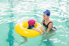 Cute little boy learning to swim with coach. At the leisure center Stock Images