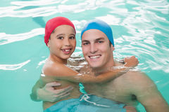 Cute little boy learning to swim with coach Royalty Free Stock Images
