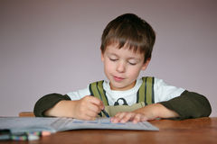 Cute little boy learning to write Royalty Free Stock Images