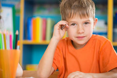 Cute little boy at lesson royalty free stock images
