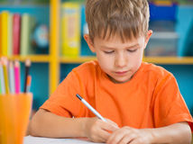 Cute little boy at lesson royalty free stock image
