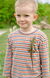Cute little boy with a live lizard on his shirt Royalty Free Stock Images