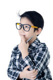 Cute little boy look like think about that with eye glasses isol Royalty Free Stock Image