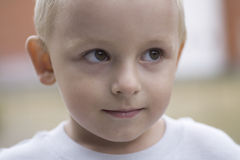 Cute Little Boy Looking Away. Closeup of cute little boy looking away Royalty Free Stock Images