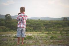 Cute little boy looking through binocular stock photos