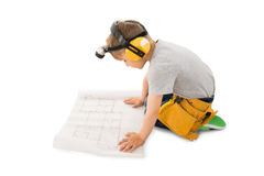 Cute Little Boy Looking At Blueprint royalty free stock photography