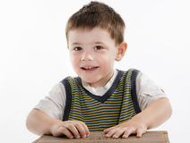 Cute little boy looking at camera Royalty Free Stock Image