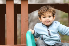 Cute little boy looking at the camera Royalty Free Stock Photos