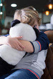 Cute little boy looking at camera while hugging panda toy Royalty Free Stock Photo