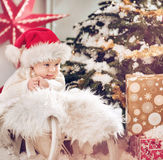Cute little boy looking at the Christmas gifts Stock Image