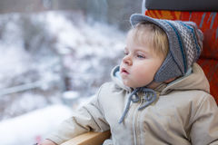 Cute little boy looking out train window. Outside, while it moving. travel Stock Photo