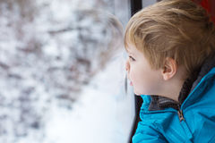 Cute little boy looking out train window Stock Photography