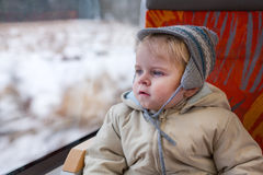Cute little boy looking out train window Royalty Free Stock Image
