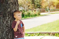 Cute little boy looking up the sky in sunny day. Child dreaming, Stock Image