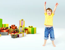 Cute little boy with lots of gifts Royalty Free Stock Photography