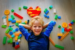Cute little boy love playing with plastic blocks. Education and learning stock images
