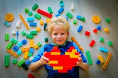 Cute little boy love playing with plastic blocks. Education and learning stock photos