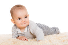Cute little boy lying on the carpet Stock Images