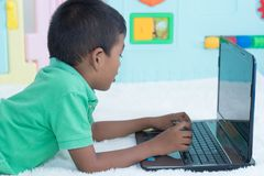 Cute little boy play computer stock images