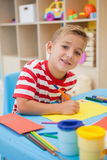 Cute little boy making art in classroom. At the nursery school stock photography