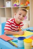 Cute little boy making art in classroom Stock Photography
