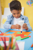 Cute little boy making art in classroom. At the nursery school stock images