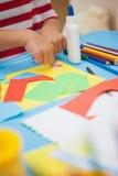 Cute little boy making art in classroom Stock Photos