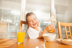 Cute little boy making breakfast in sunny morning Royalty Free Stock Photos