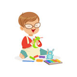 Cute little boy making figures from a plasticine, kids creativity vector Illustration. Cute little boy making figures from a plasticine, education and child Stock Images