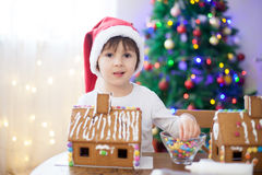 Cute little boy, making gingerbread cookies house for Christmas Stock Images