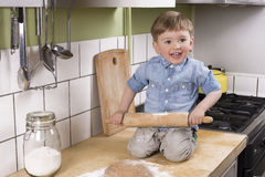 Cute little boy making pizza Royalty Free Stock Photo