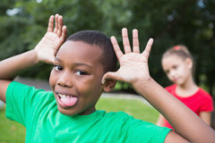 Cute little boy making silly faces outside Royalty Free Stock Images