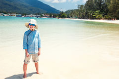 Cute little boy on Malibu beach at Koh Phangan Island, Thailand Royalty Free Stock Images