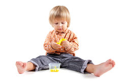 Cute little boy molding plasticine Stock Photography